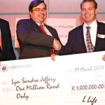 Handing over a Million Rand as part of Howard's innovative 'Get a Plan - Get a Life' promotion for Liberty Group.